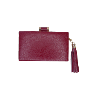 Front view of the red clutch showing tassle