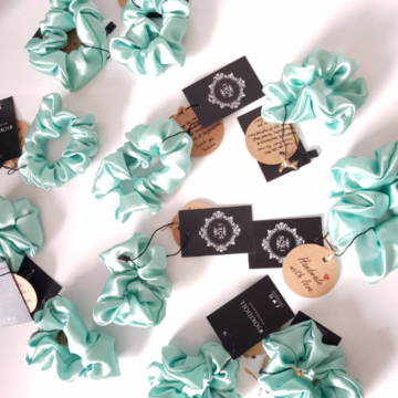 Several Mint green scrunchies with Styles of Soki labels